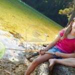 11239077-happy-girl-fishing-at-lake